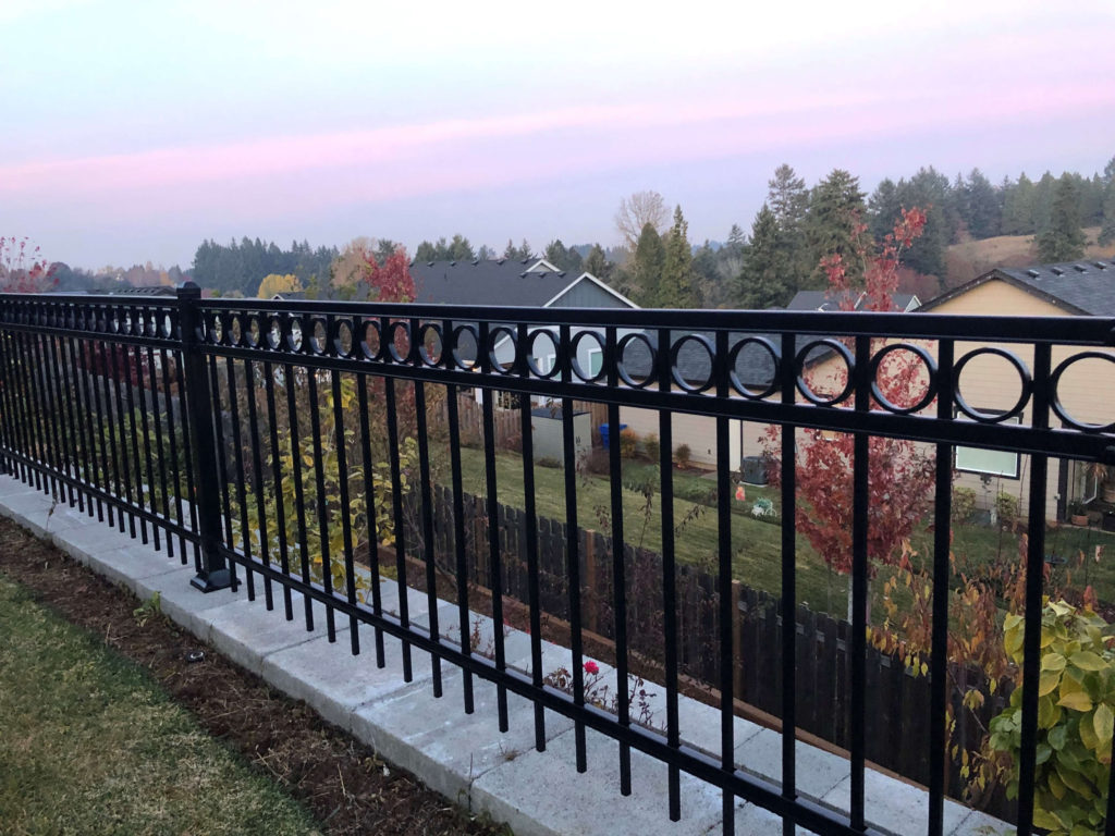 An ornamental iron fence installation by F&W Dallas fence company