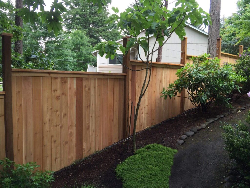 A wood fence installation by F&W Aumsville fence company