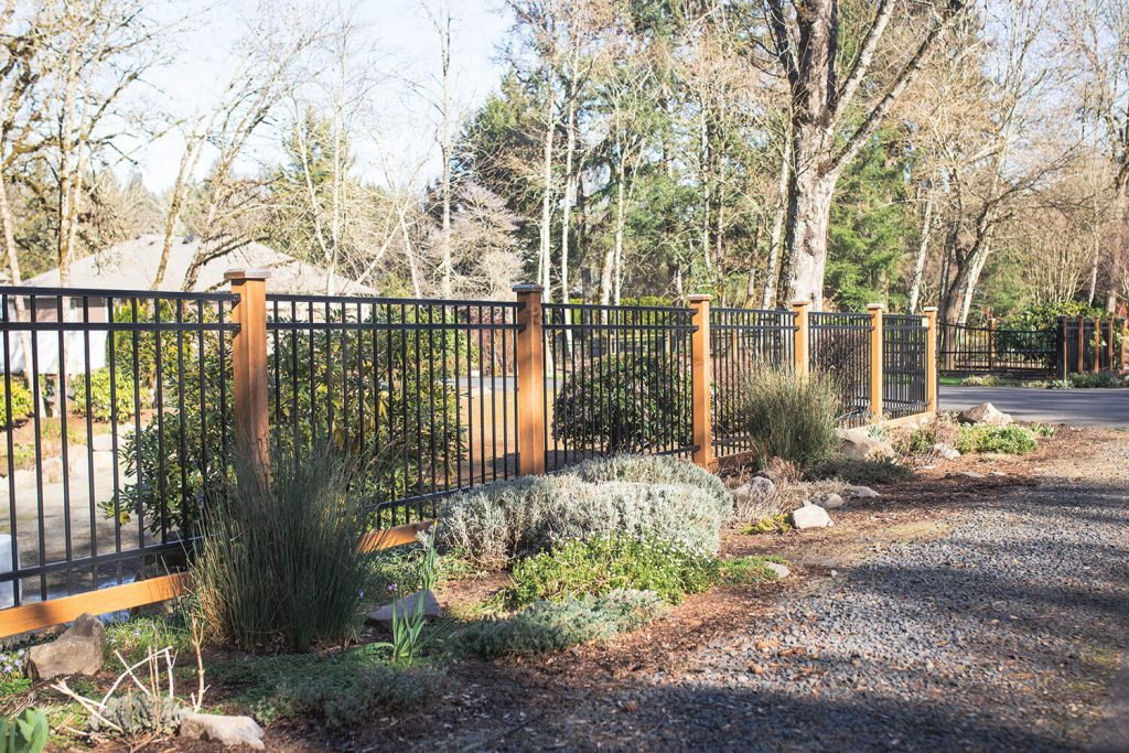 An ornamental iron fence installation by F&W Dallas steel fence contractors